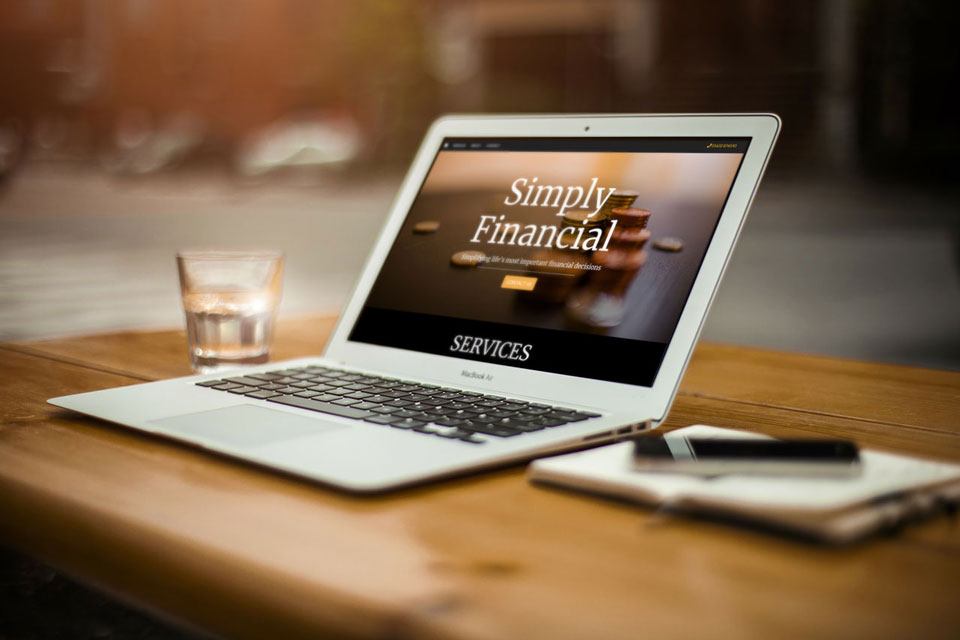 Financial website displayed on laptop